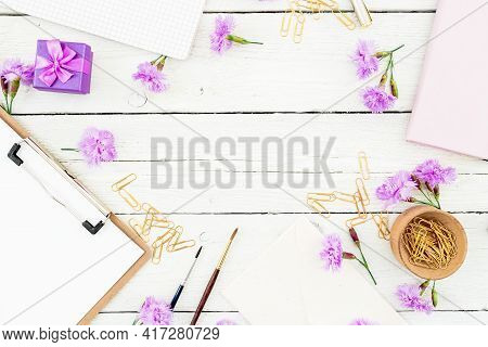 Workspace With Clipboard, Notebook, Flowers And Accessories. Female Blog Workspace. Flat Lay, Top Vi