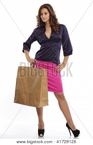 Cute brunette with a shopping bag