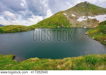 Summer Scenery With Lake On High Altitude. Beautiful Landscape Of Fagaras Mountain Ridge In Summer.