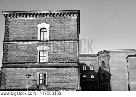 Historic Brick Tenement Houses In The City Of Poznan, Monochrome