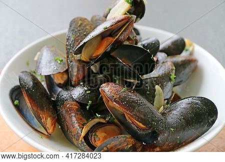 Closeup Of Mouthwatering Belgian Steamed Mussels In White Wine And Garlic Or Moules Mariniere