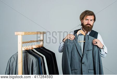 Shopper Hipster Man In Fitting Room Menswear Store, Try On A Suit Concept