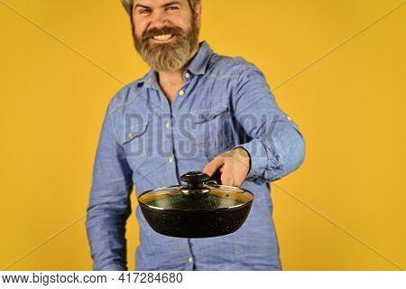 Hold Frying Pan. Best Quality. Bearded Cook Portrait With Kitchen Tools. Bearded Man Hold Cooking Pa
