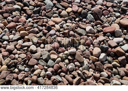 Pebbles At A Coastal Beach Location In Springtime For Background