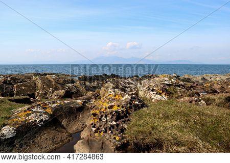 Sea View With Coastal Rocks To Isle Of Arran Ayrshire Scotland