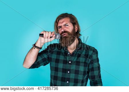 Emotional Hipster With Mic. Male Singer With Microphone. Karaoke Concept. Bearded Man In Checkered S