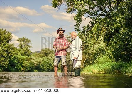 Good Production. Fly Fishing Adventures. Friends Men With Fishing Rod And Net. Hobby Of Businessman.