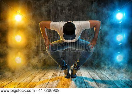 Hip Hop Dance. Young Man Break Dancer. Dancing In Stage Club Lights Smoke Over Grunge Floor And Wall