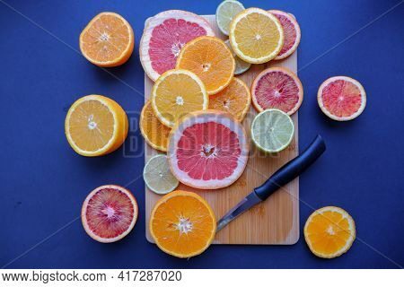 In The Photo, Cut Fruits In Circles: Oranges, Tangerines, Lemon, Lime, Grapefruit. The Composition O