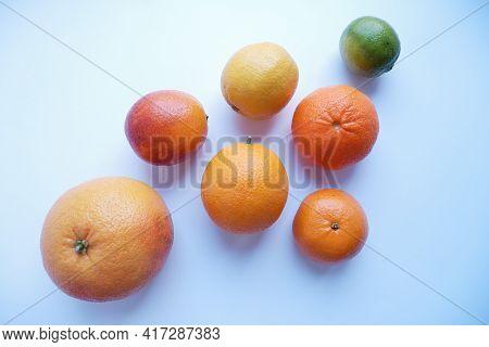 On A White Background, Oranges, Tangerines, Lemon, Lime, Grapefruit. The Composition Of Fresh Citrus