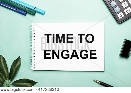 Time To Engage Is Written On A White Sheet On A Blue Background Near The Stationery And The Scheffle