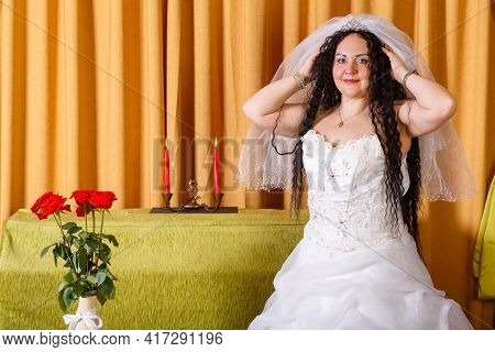 A Jewish Bride In A White Wedding Dress Wears A Veil Before The Chuppah Ceremony. Horizontal Photo