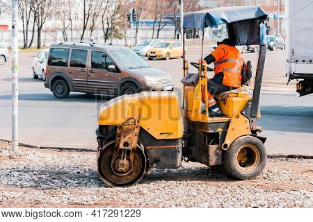 Road Worker Work On A Small Roller Machine To Smooshs Rubble Down. Equipment. Constriction. Asphalt.