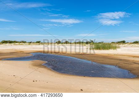 Sand And Lake With Blue Sky In Lagoa Dos Barros Lake, Osorio, Rio Grande Do Sul, Brazil
