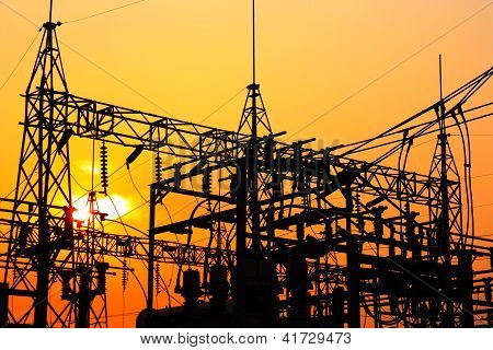 High voltage power plant and transformation station at sunset poster