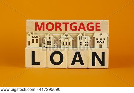 Mortgage Loan Symbol. Models Of A Wooden House. Words 'mortgage Loan' On Wooden Block. Copy Space. B