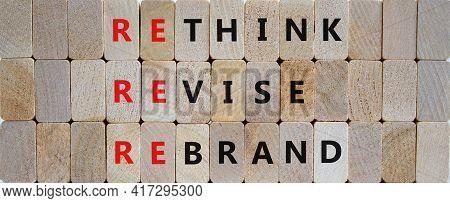 Rethink, Revise, Rebrand Symbol. Wooden Blocks With Words 'rethink, Revise, Rebrand'. Beautiful Wood