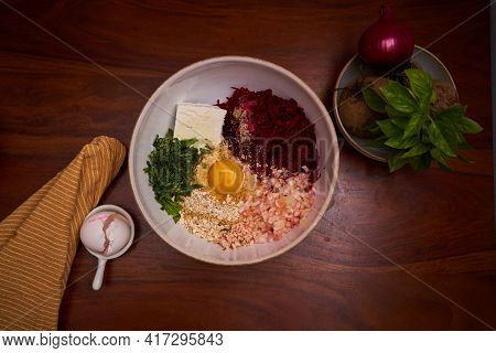 Veggie Burger Ingredients In Bowl With Decoration