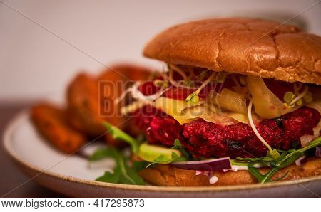 Veggie Burger Red Beet With Fries In The Background