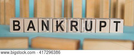 Bankrupt Word Written On Wooden Blocks On Light Blue Background.