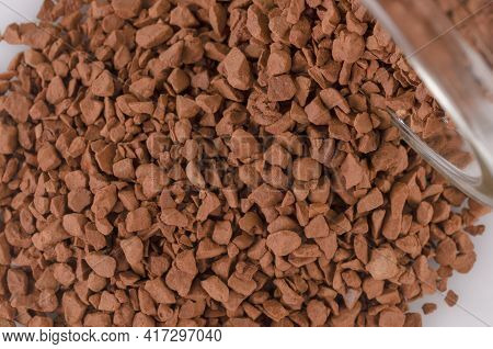 Instant Coffee Granules Lying On The Surface. Kofk Granules Spilled Out Of The Jar Lying On The Tabl