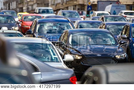 Bucharest, Romania - April 08, 2021: Cars In Traffic At Rush Hour On A Boulevard In Bucharest.