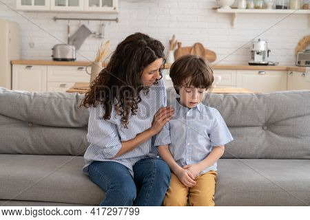 Mother Trying To Distract Upset Kid. Young Mom Engaging Depressed Offended Son In Bad Mood By Hug. C