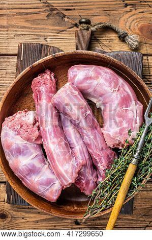 Fresh Raw Turkey Necks Meat In A Wooden Plate With Thyme. Wooden Background. Top View