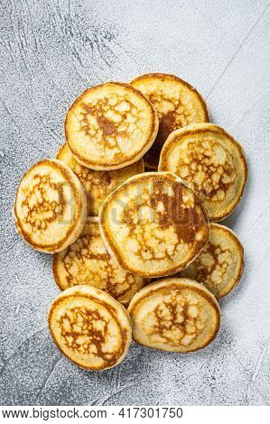 Stack Of Buttered Pancakes On A Kitchen Table. White Background. Top View