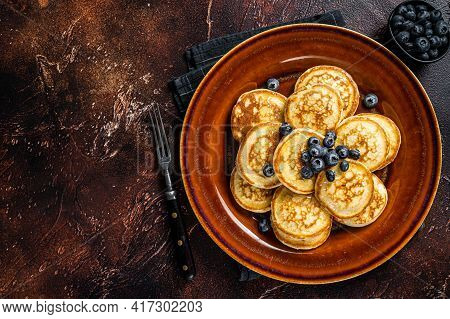 Plate With Pancakes With Fresh Blueberries And Syrup . Dark Background. Top View. Copy Space