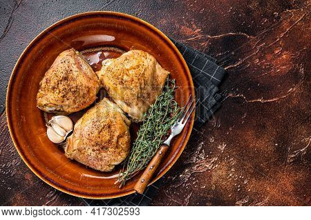 Roasted Chicken Thighs With In A Plate. Dark Background. Top View. Copy Space