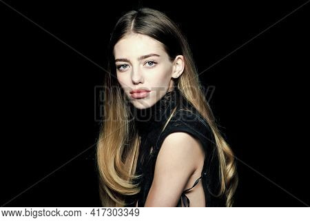 Beauty Girl With Healthy Skin. Fashion Model Pose Isolated On Black Background. Beauty And Fashion S