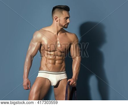 Sexy Man Isolated Full Body. Athletic Bodybuilder Man On Blue Background. Coach Sportsman With Bare
