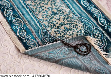 Praying In The Month Of Ramadan, Prayer Rugs Laid On The Ground, Islam And Prayer Rugs,