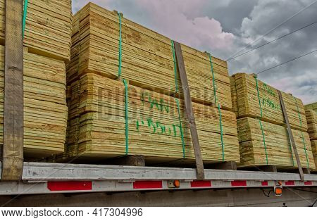 Augusta, Ga Usa - 03 31 21: Stacks Of Palletized Strapped Down Lumber Planks On A Truck Bed
