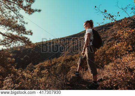 Concept Of Hiking And Adventure Alone. Summer Travel Of Teenager Girl With Backpack In The Mountains