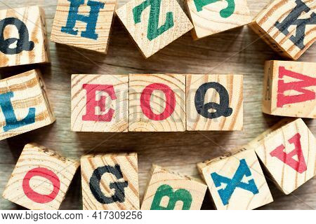 Alphabet Letter Block In Word Eoq (abbreviation Of Economic Order Quantity) With Another On Wood Bac