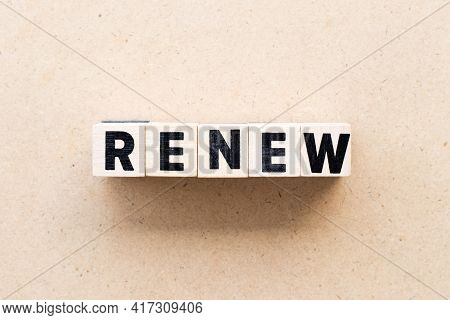 Letter Block In Word Renew On Wood Background