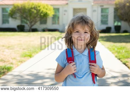 Pupil Go To School. Elementary Student. Pupil Of Primary School Go Study With Backpack Outdoors.