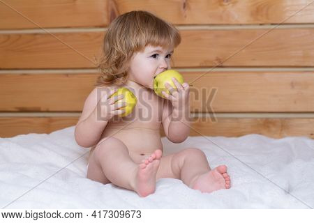 Cute Baby Eat Apple. Funny Baby Eat Apples. Kid Eating Fruit. Healthy Nutrition For Kids. Solid Food