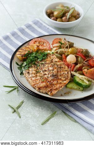 Grilled Turkey Breast With Fresh Salad. Bright Background.