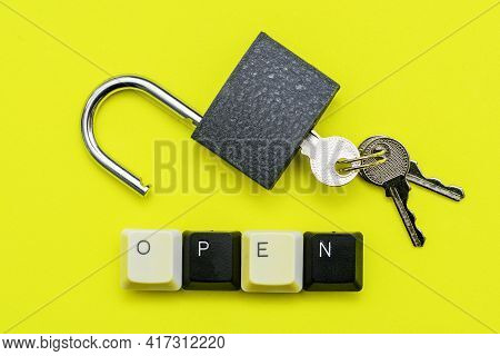 An Open Lock With Keys On A Yellow Background The Word Open Concept Is Laid Out At The Bottom Of A C