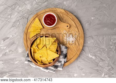 Tortilla Or Nacho Chips For Snack. Corn Chips Nachos On Grey Background, Top View