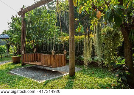 Wooden Swing With Rope Swing Hanging For \neveryone In Garden