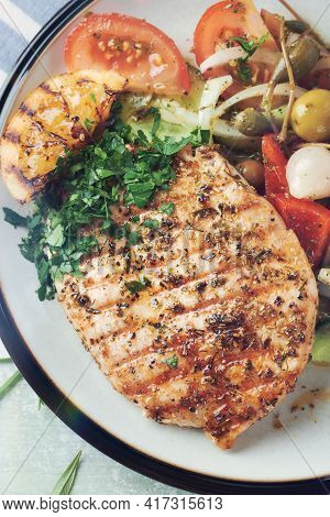 Grilled Turkey Breast With Fresh Salad. Bright Background. Close Up. Top View.