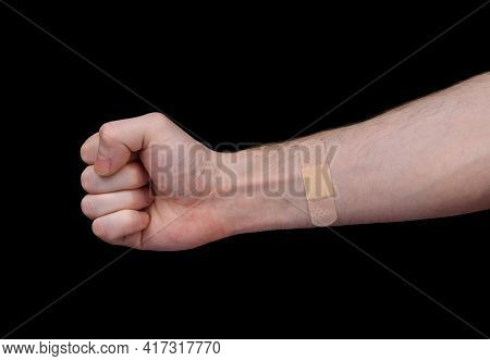 An Adhesive Plaster Is Glued To The Man's Forearm