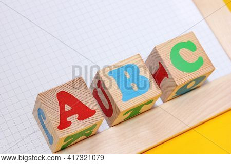 Abc -the First Letters Of The English Alphabet On Wooden Toy Blocks . English For Beginners Concept.