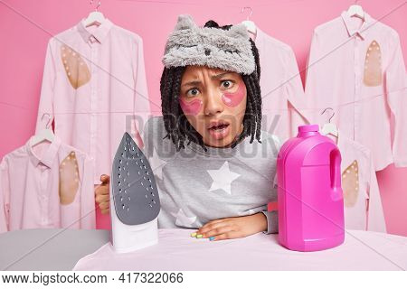 Displeased Indignant Young African American Girl Looks Indignant At Camera Uses Electric Iron For Ir