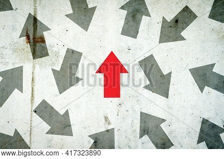 Arrows In Different Directions On A Concrete Wall. Red Arrow, Right Direction. Leadership Concept. T