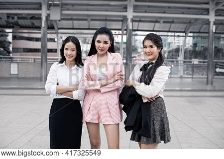 Group Of Woman Cross One's Arm With A Smile.
